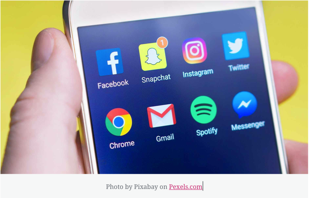 Picture of a phone with social media icons showing