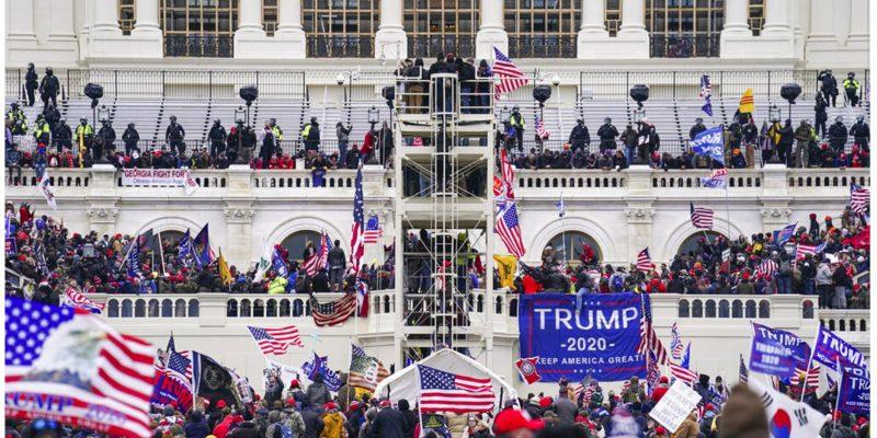 photo of Capitol swarm AP Photo/John Minchillo