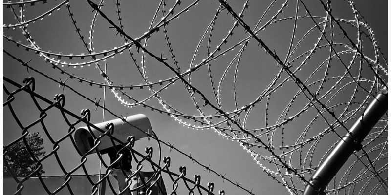 barbed wire and surveillance camera